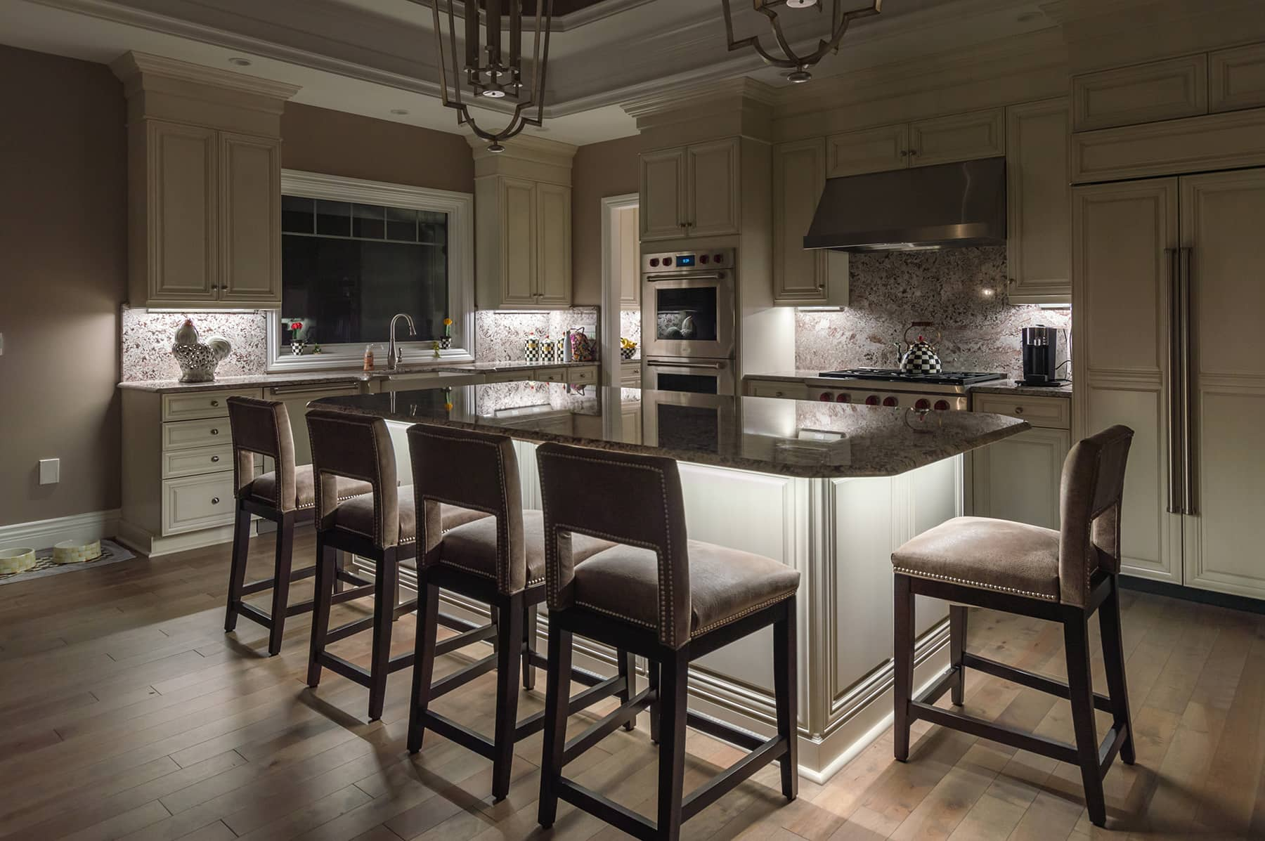 An upscale kitchen with professional lighting